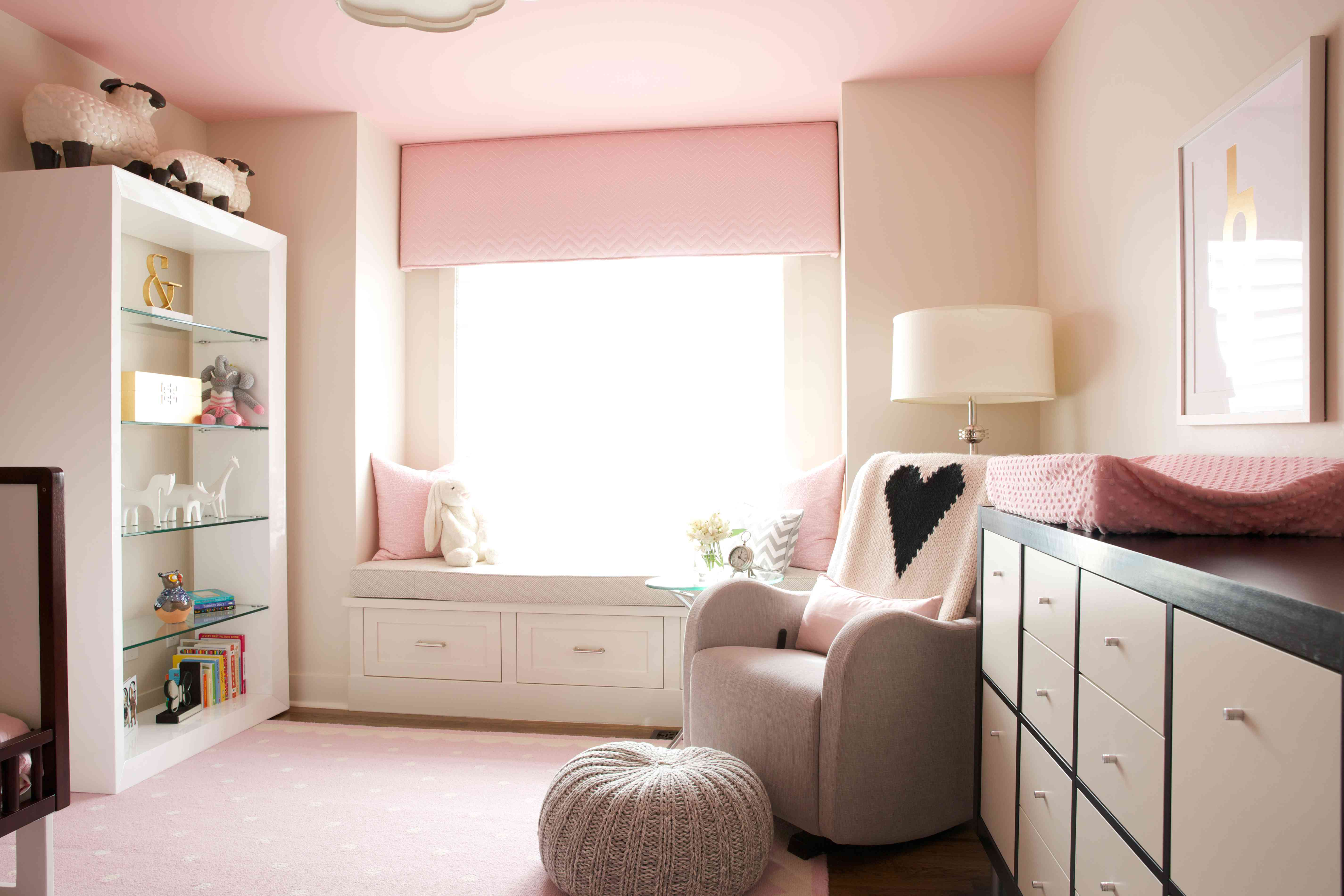 Girls bedroom with a window bench