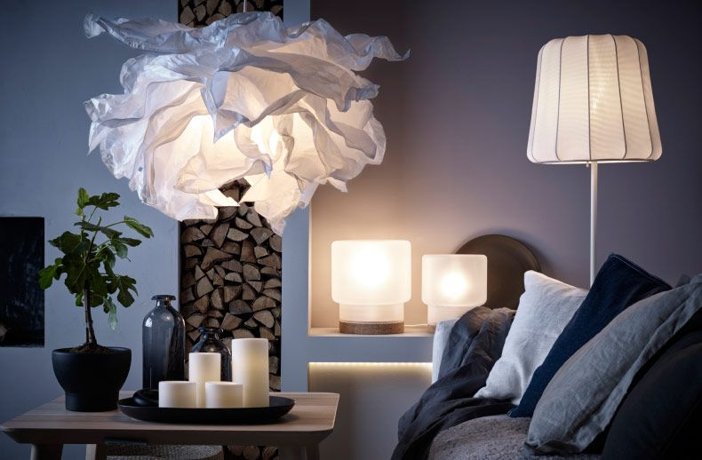 modern room with low light, wood stacked in wall