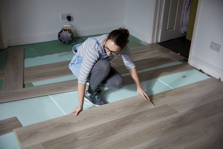 Woman laying floorboards
