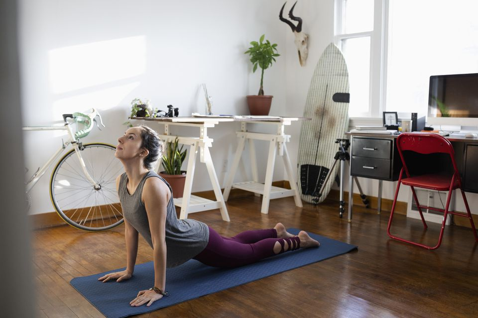 Woman doing yoga in room