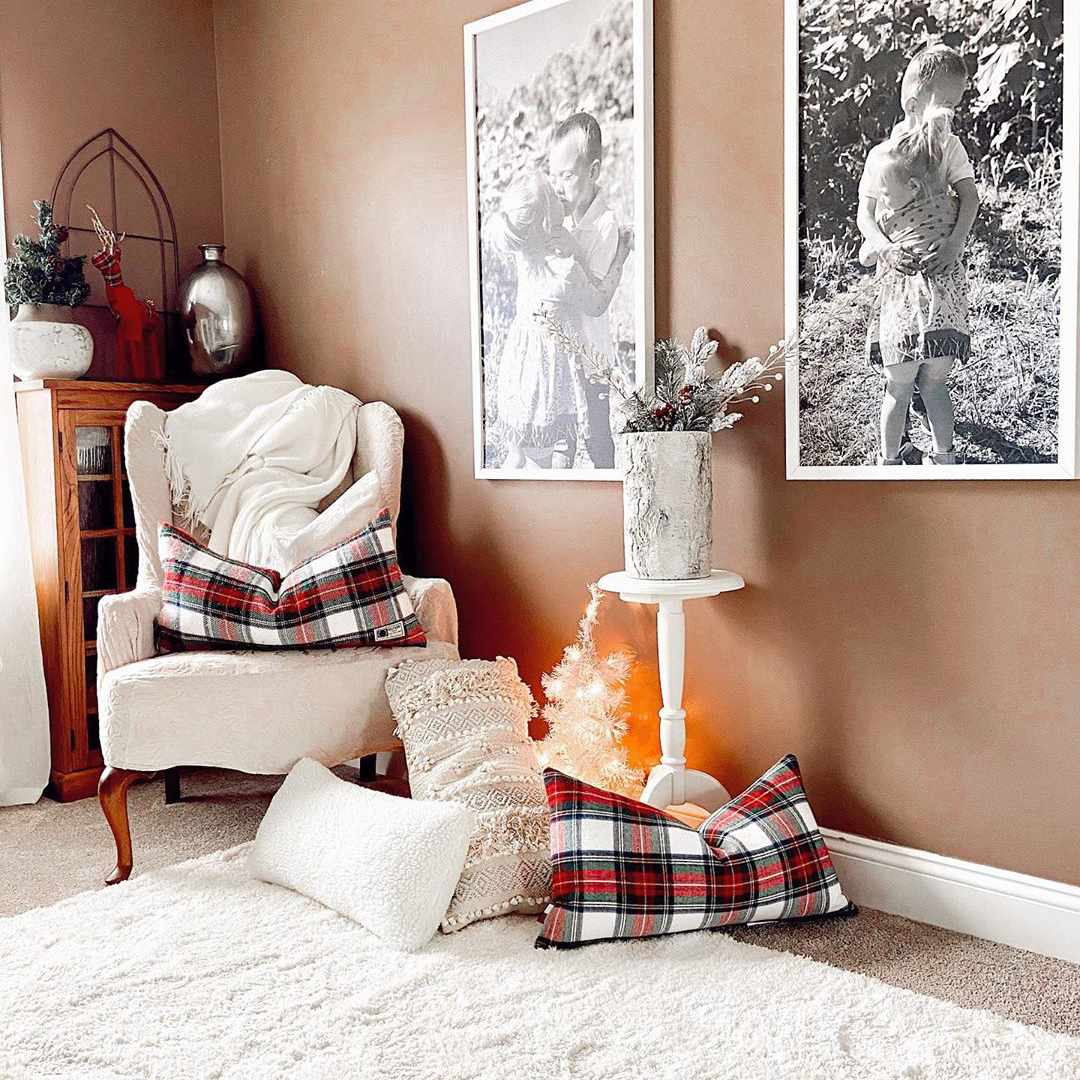 Living room with brown walls and red plaid pillow