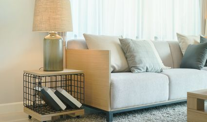 End table and sofa in a beige house.