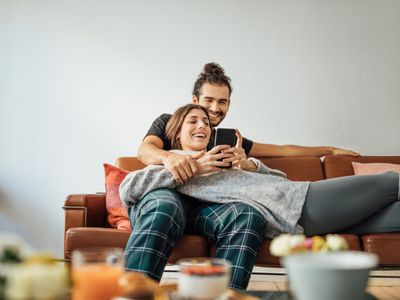couple lying on couch