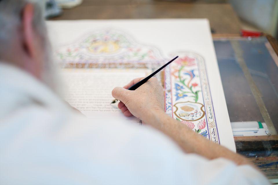 Scribe filling in a Ketubah