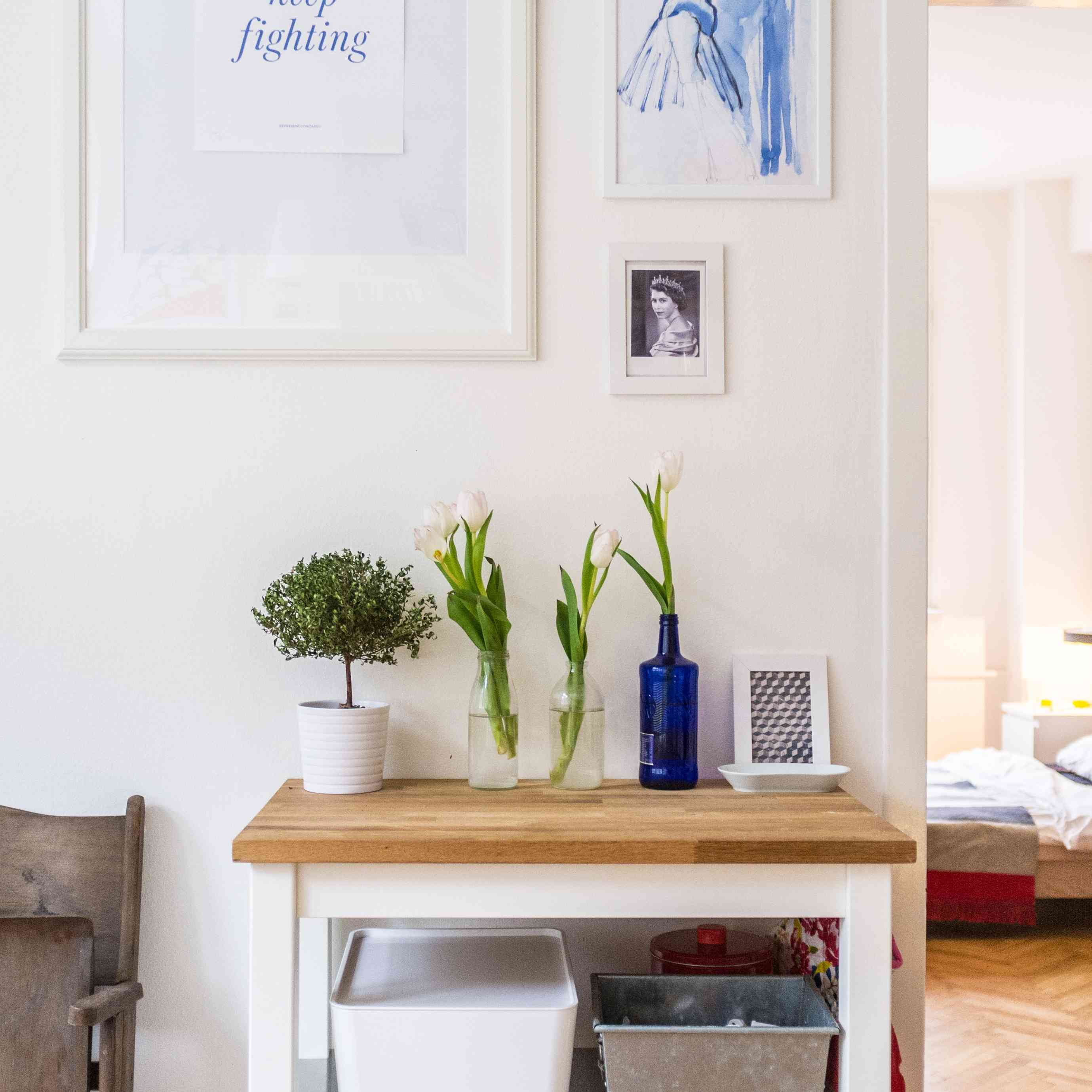 White picture frames with a table and plants