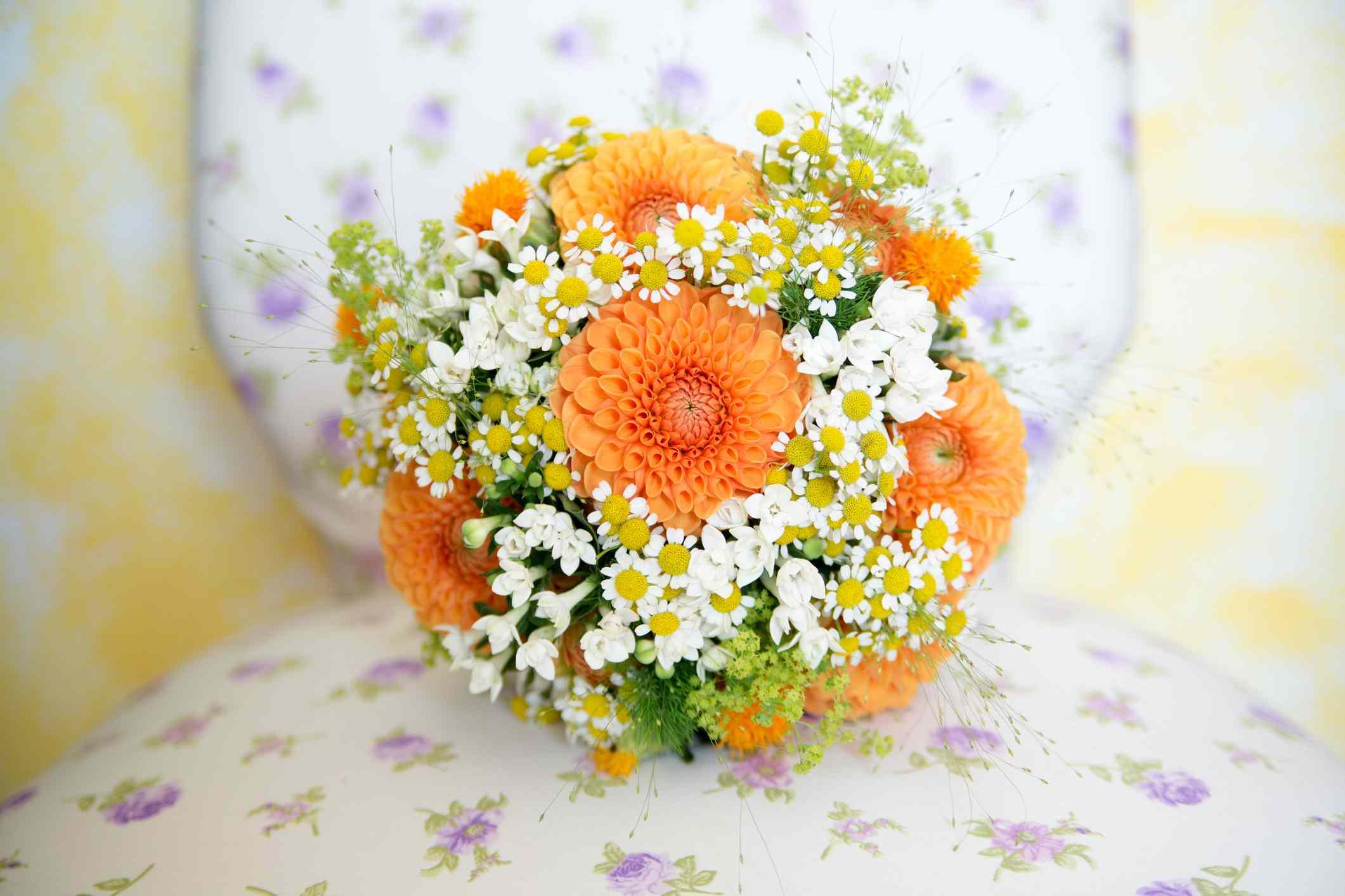 Close up of orange dahlia bouquet