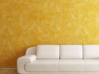 Intetior Room with Orange Wall and White Sofa