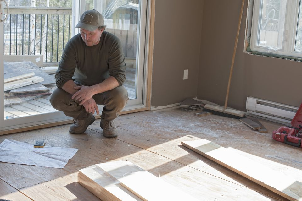 Contractor looking at blue prints In a new home