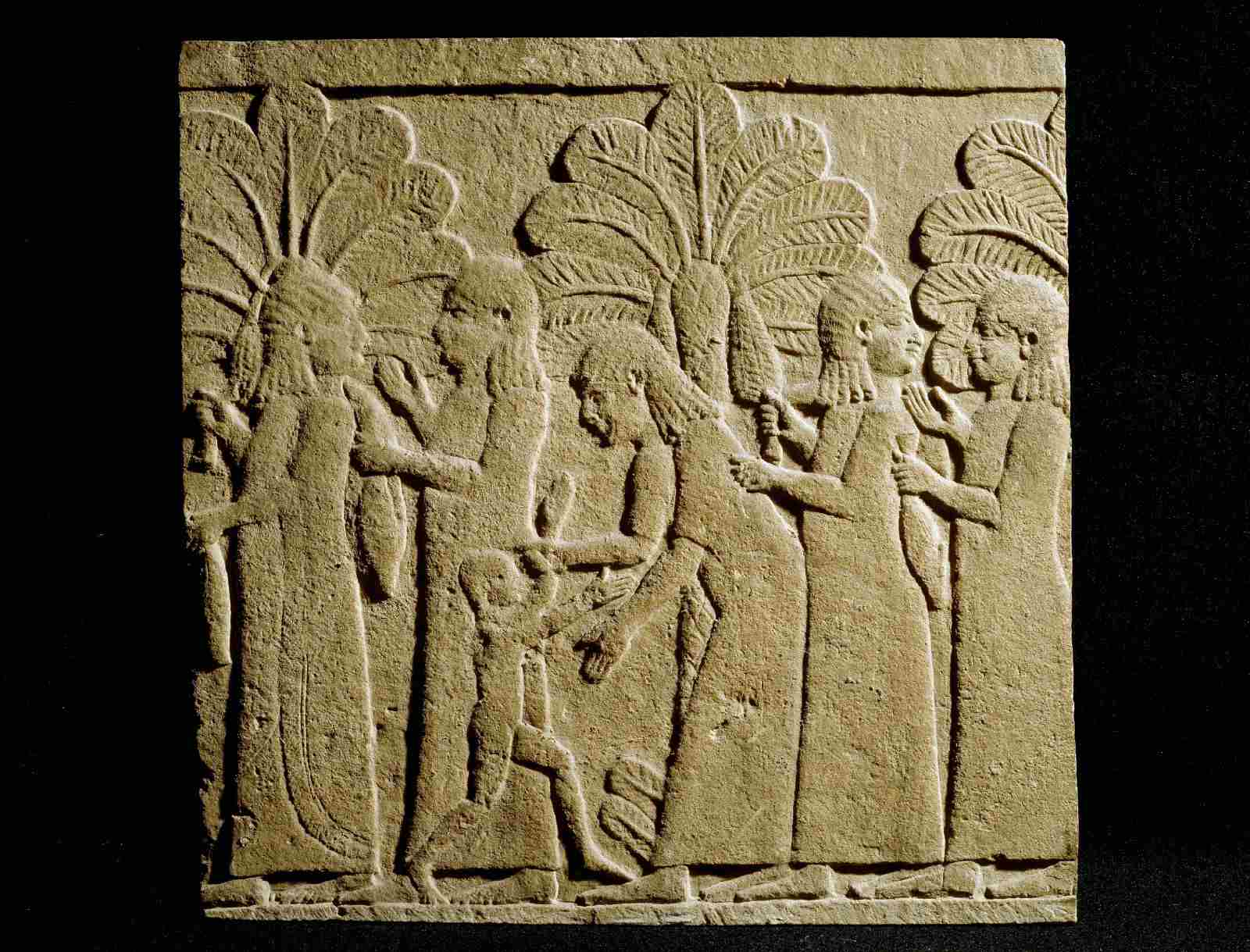 ancient relief with palms