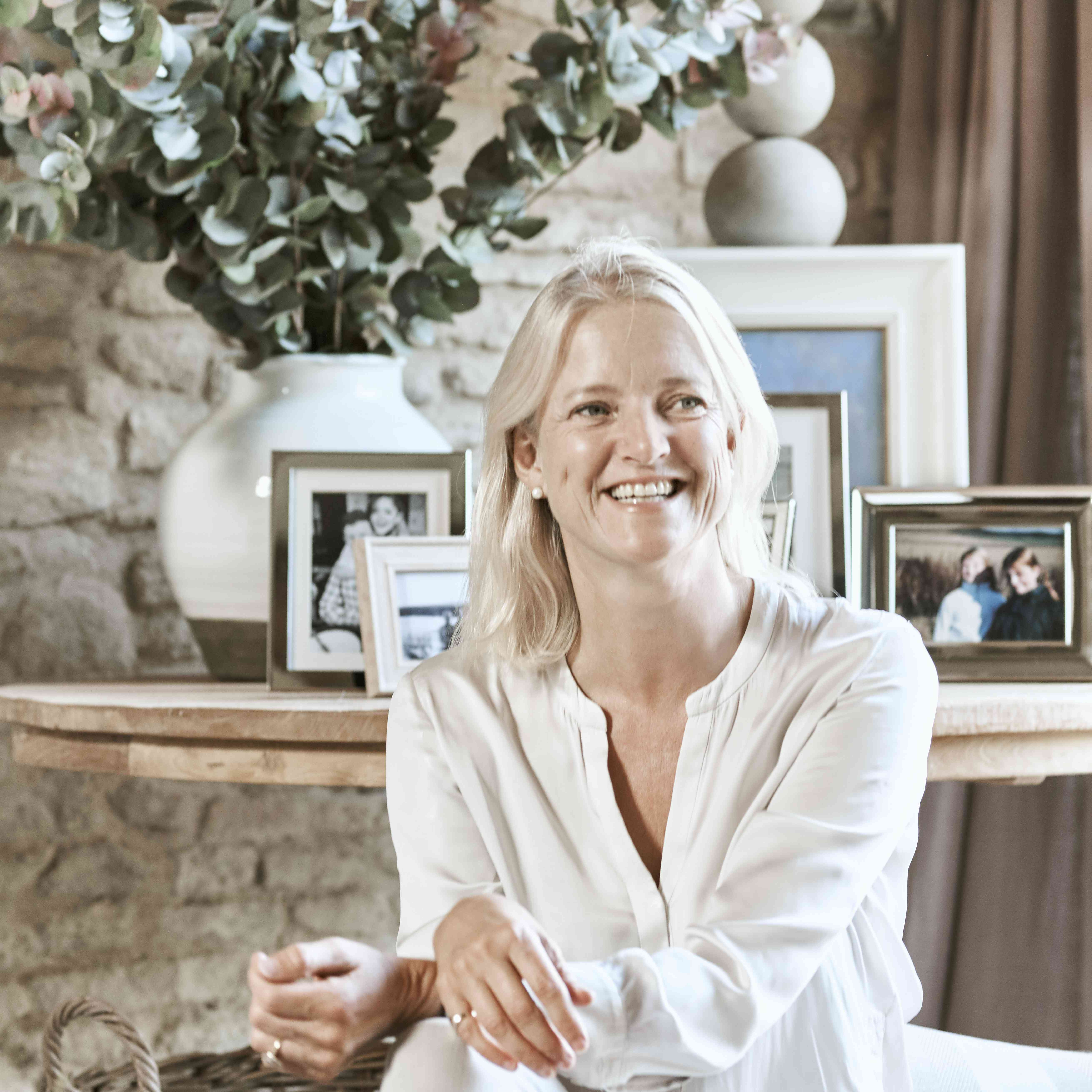 Emma Sims-Hillditch of Sims Hillditch poses in a neutral living area