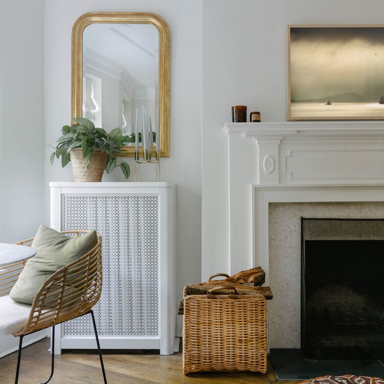 A rattan chair is positioned near a living room