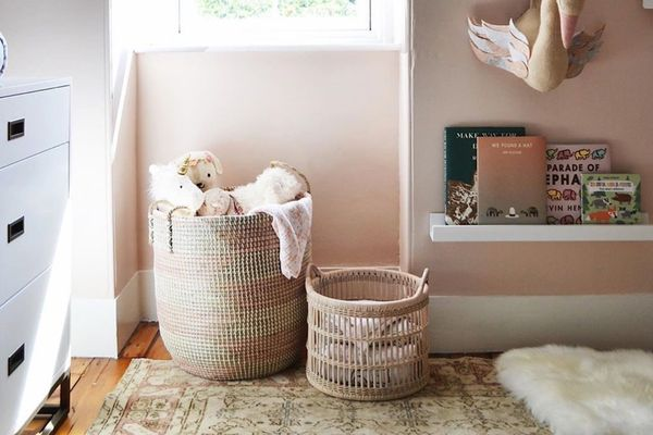 Stuffed animals stored in a straw basket
