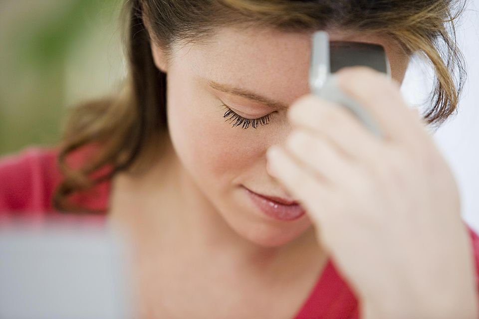 Stressed woman with cellphone