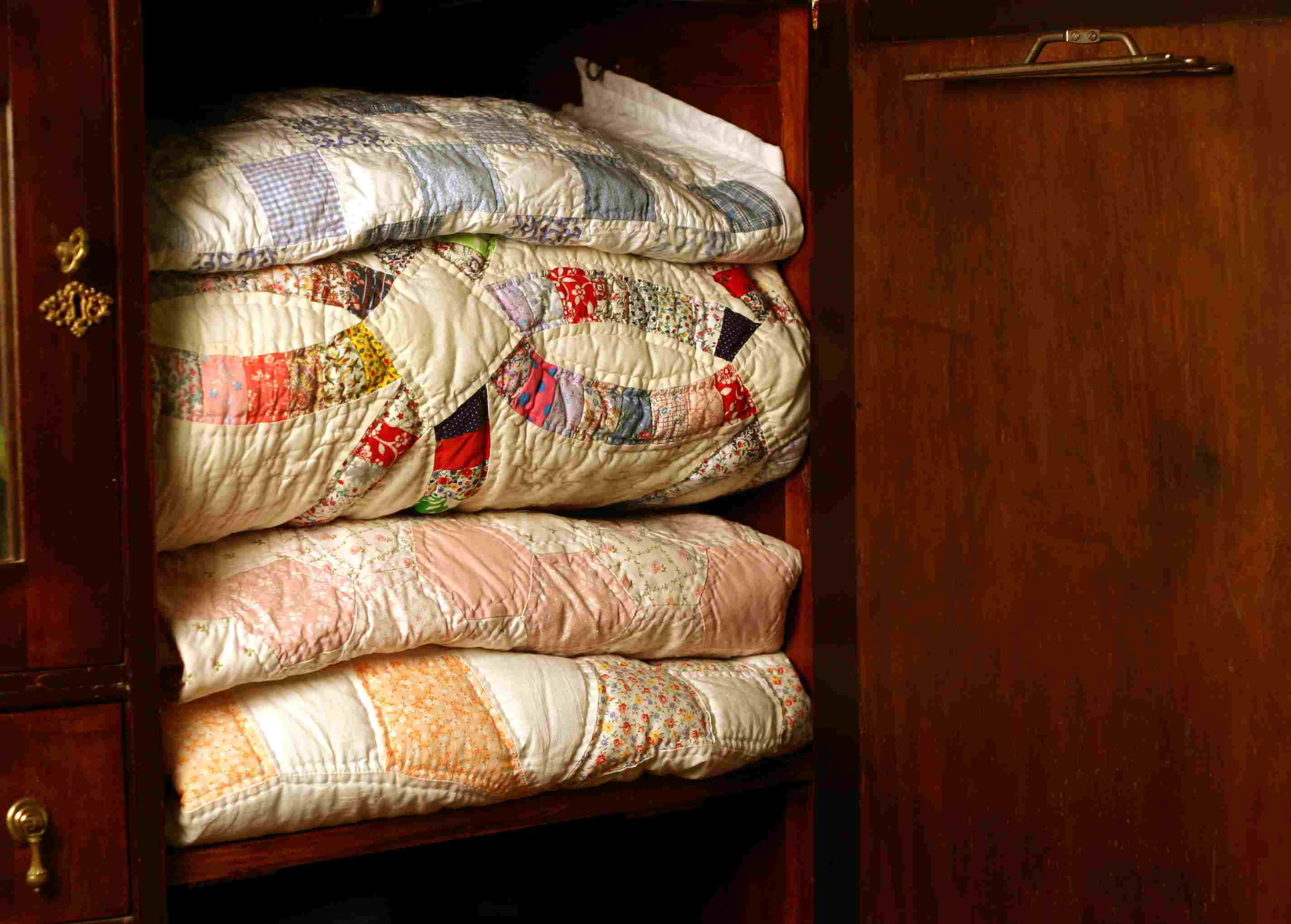 Quilts folded in a closet