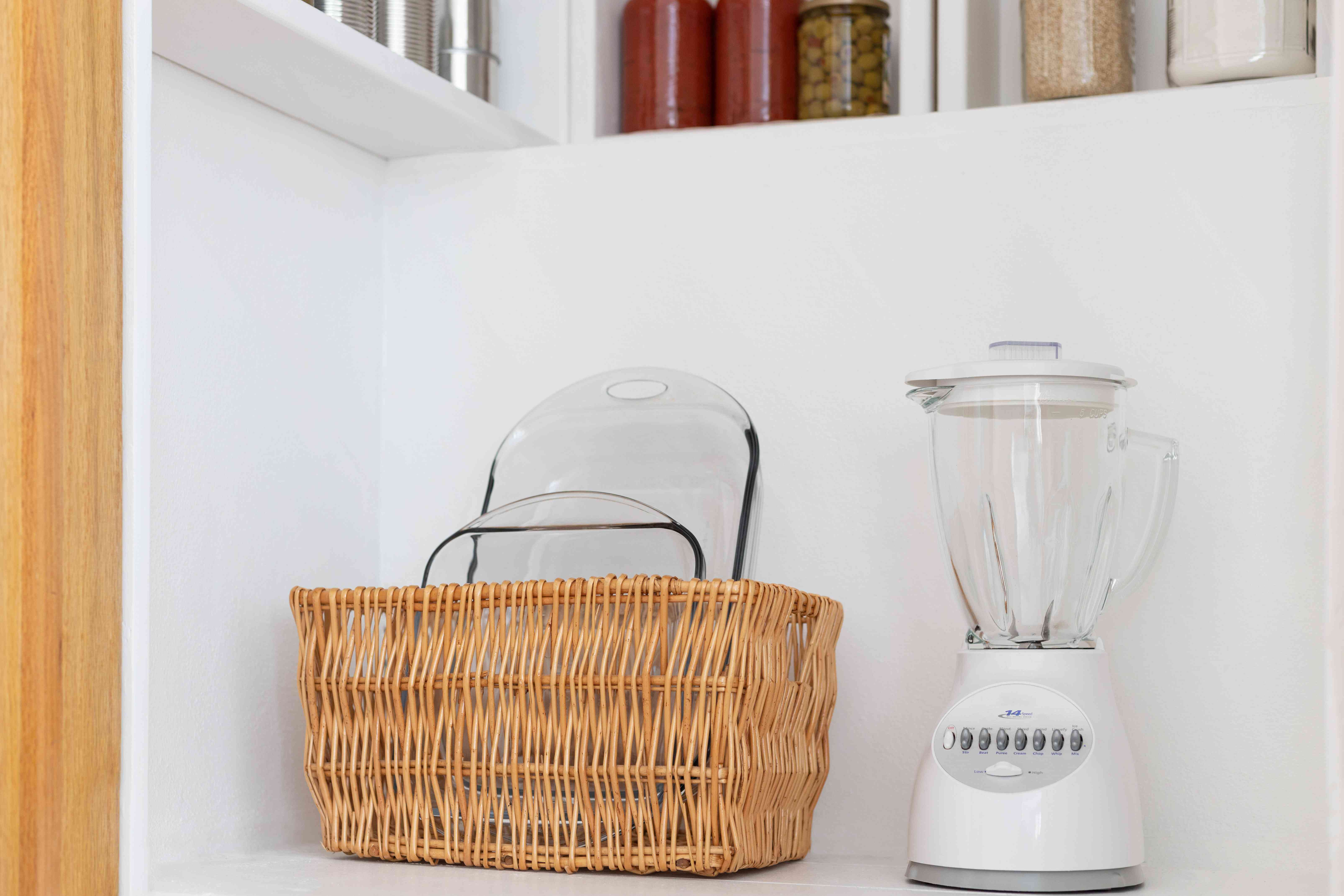 storing appliances and casserole dishes in the pantry