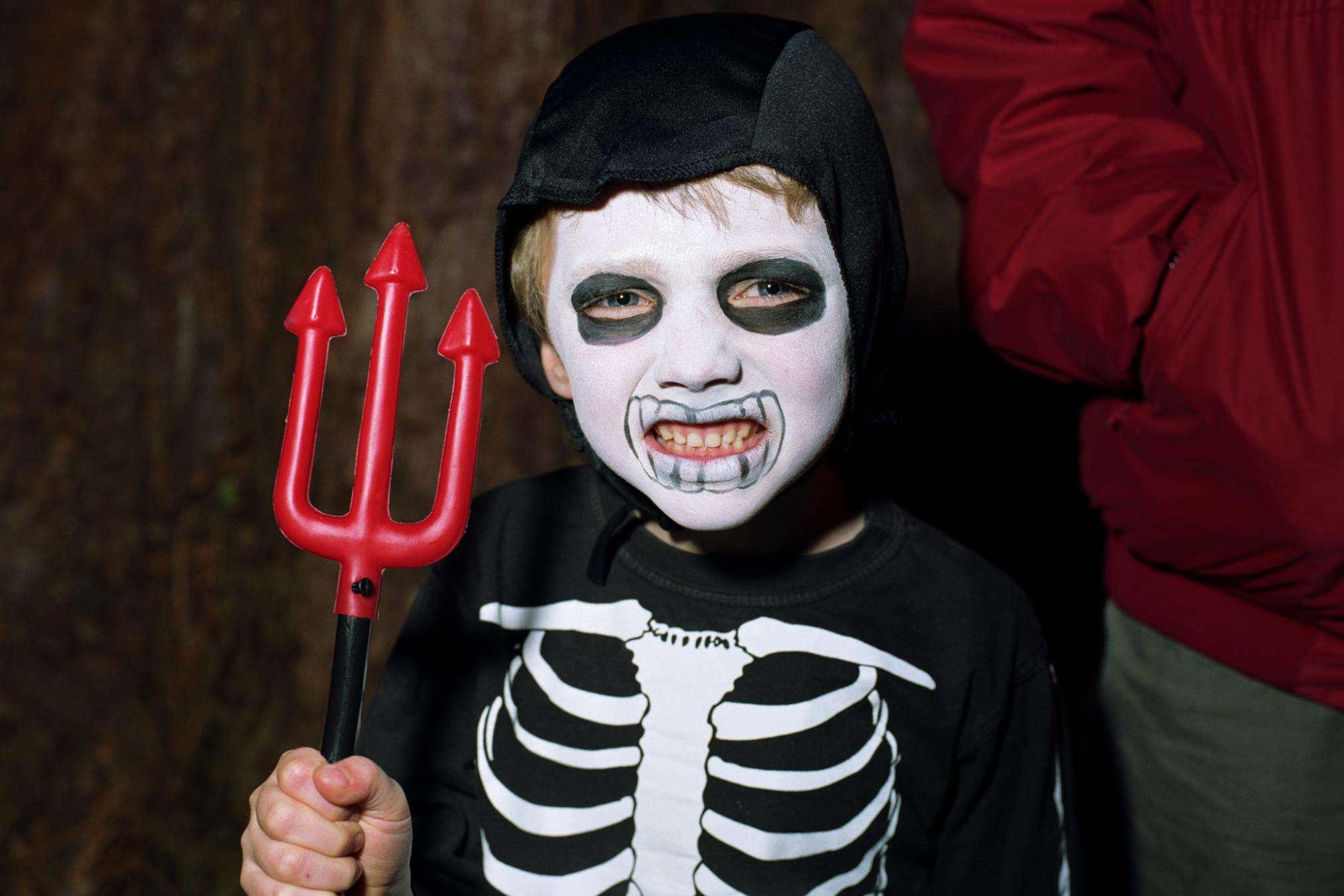 Boy wearing skeleton costume, portrait, close-up