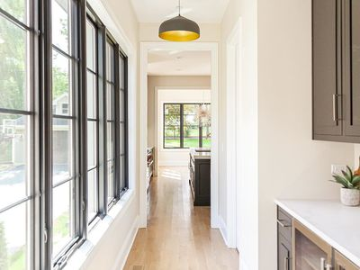 Butler's pantry with large hanging pendant lights