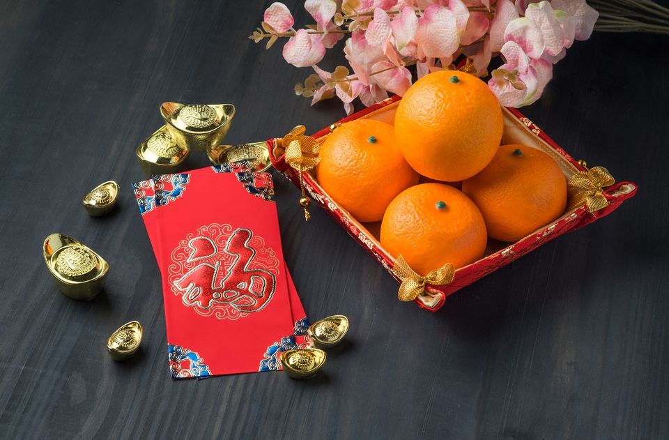Red Envelope Packe With Ingots, Oranges and Flower on Table