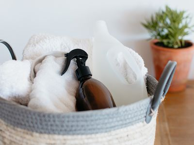 basket of laundry and detergent