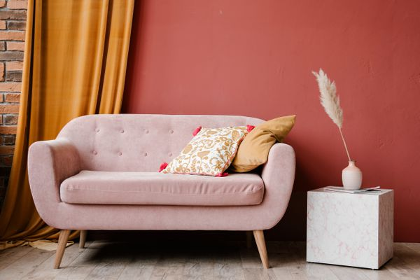 bold accent wall and pink sofa