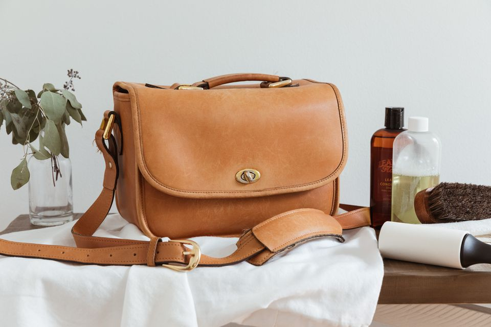 A leather purse and cleaning materials