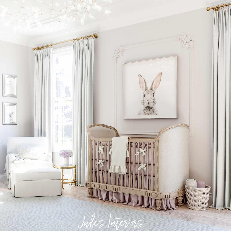 white nursery with bunny artwork hanging over crib