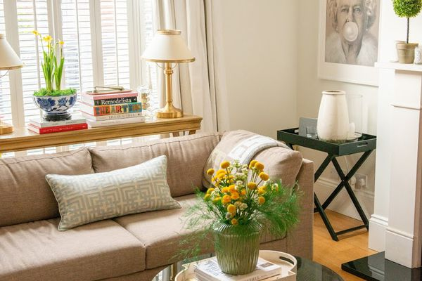 living room with curved arm couch and circle coffee table