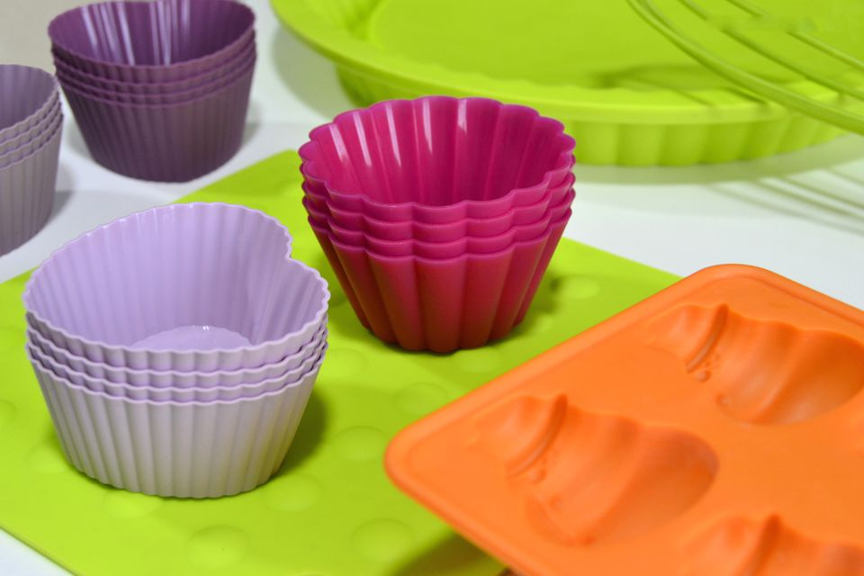 Brightly colored silicone cups, molds, and cookware