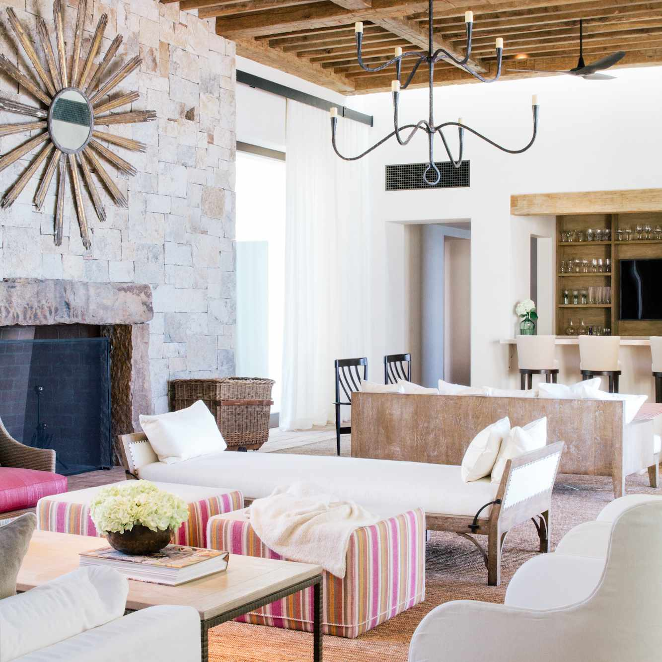 A living room with multiple sitting areas, designed by LA-based Chris Barrett