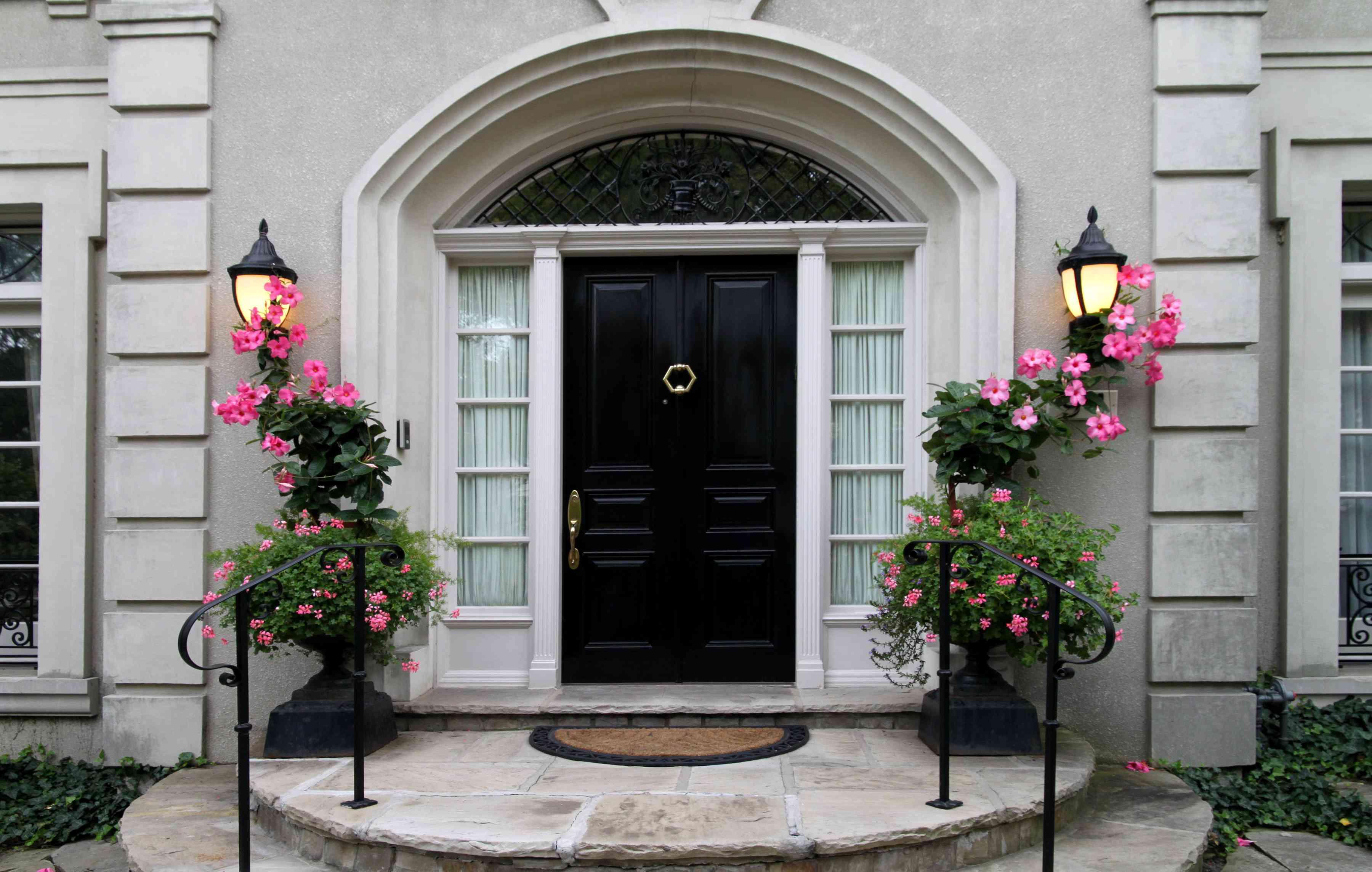Elegant black front door with flowers