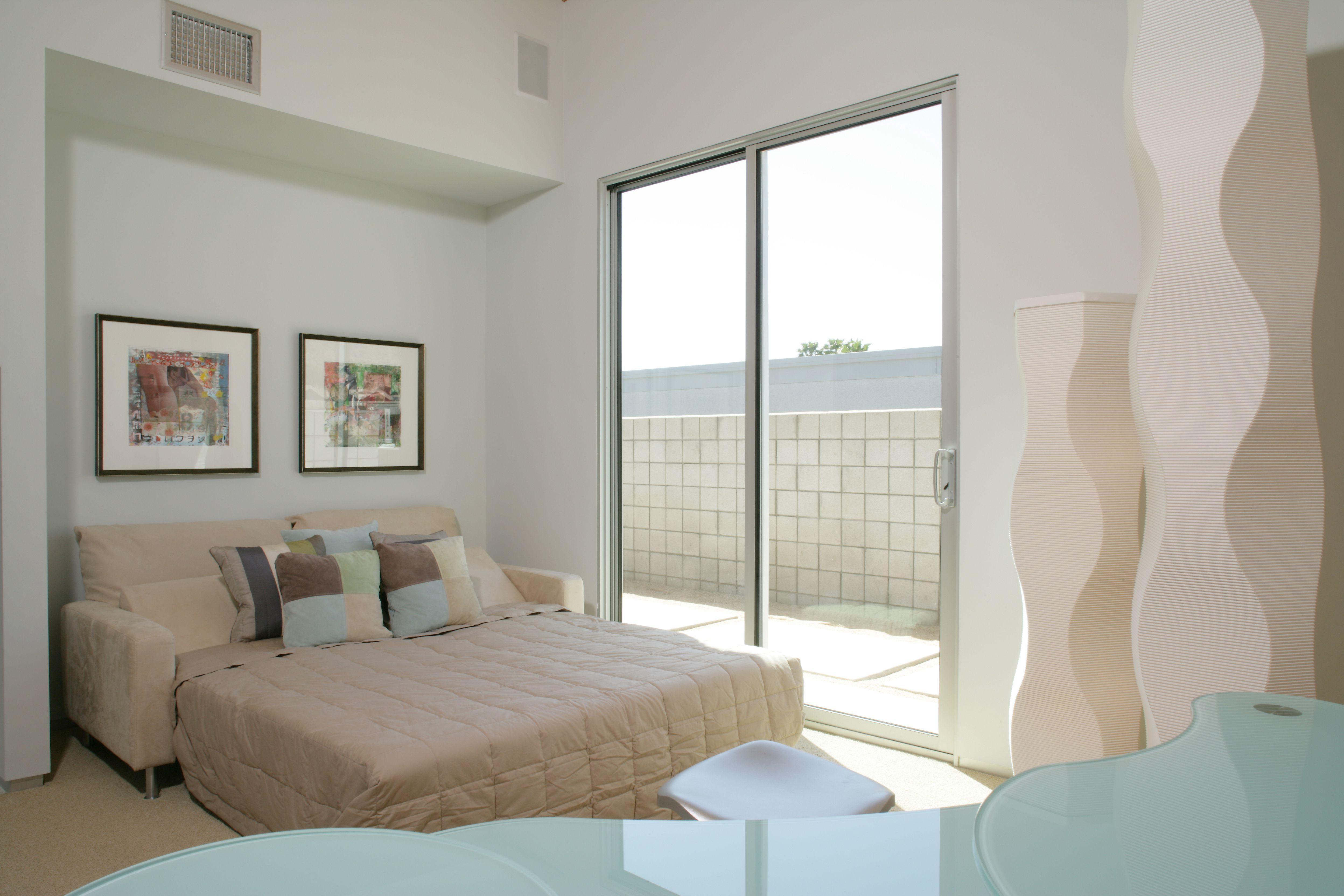 Sofa Bed by Patio Door in Contemporary Bedroom