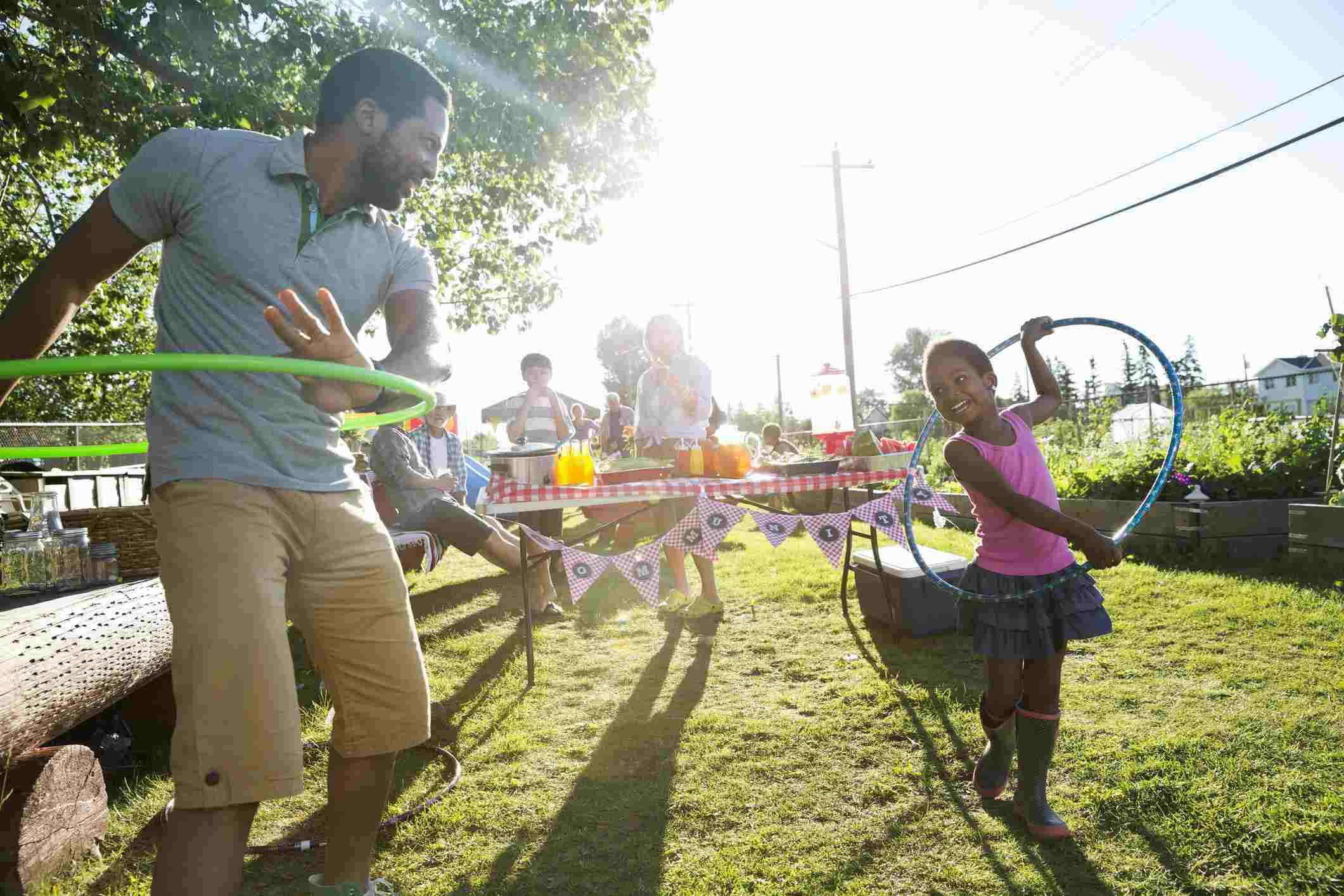 Father and daughter hula-hooping