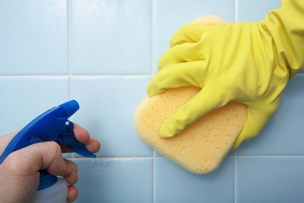 hands cleaning tiles
