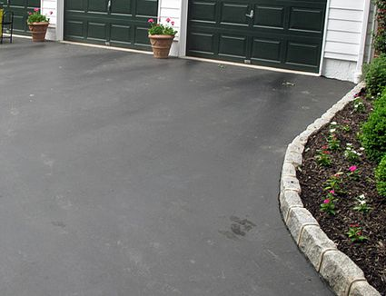 Is a tar and chip driveway right for your home 9 steps to driveway edging with cobblestone pavers solutioingenieria Gallery
