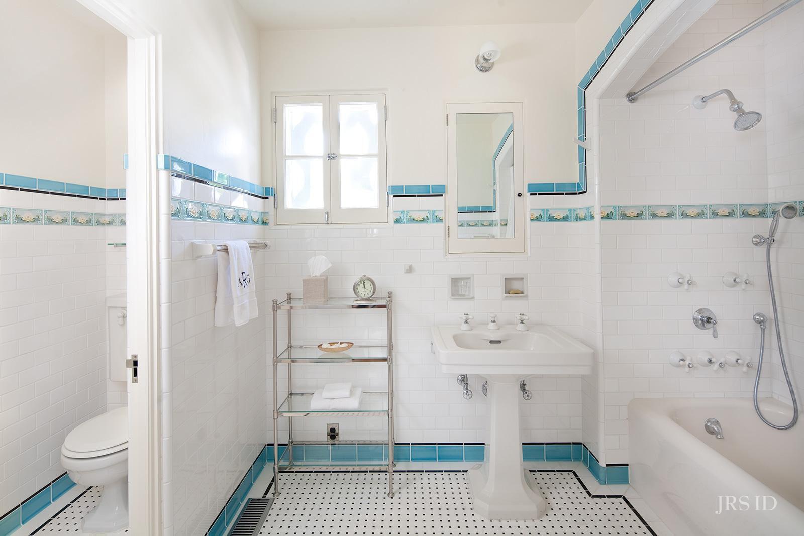Blue tile in a vintage inspired bathroom.