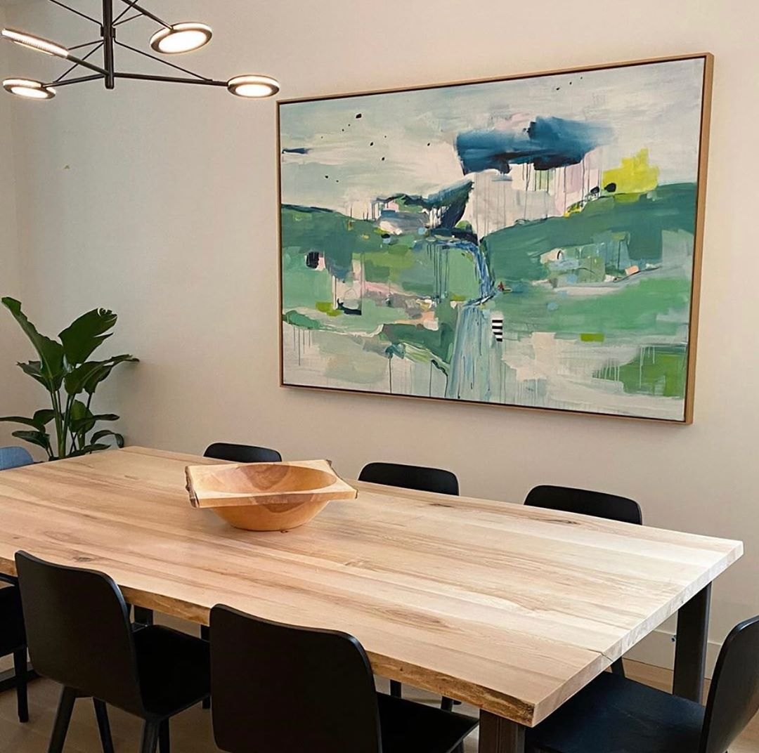 Modern dining room with an abstract art piece