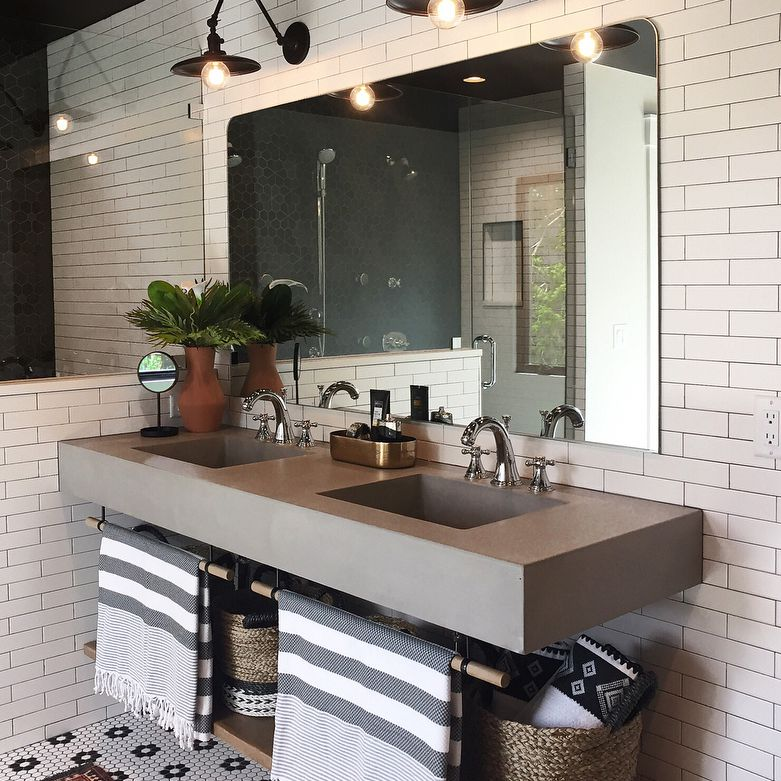 Updated bathroom with tiled floor and cement sink