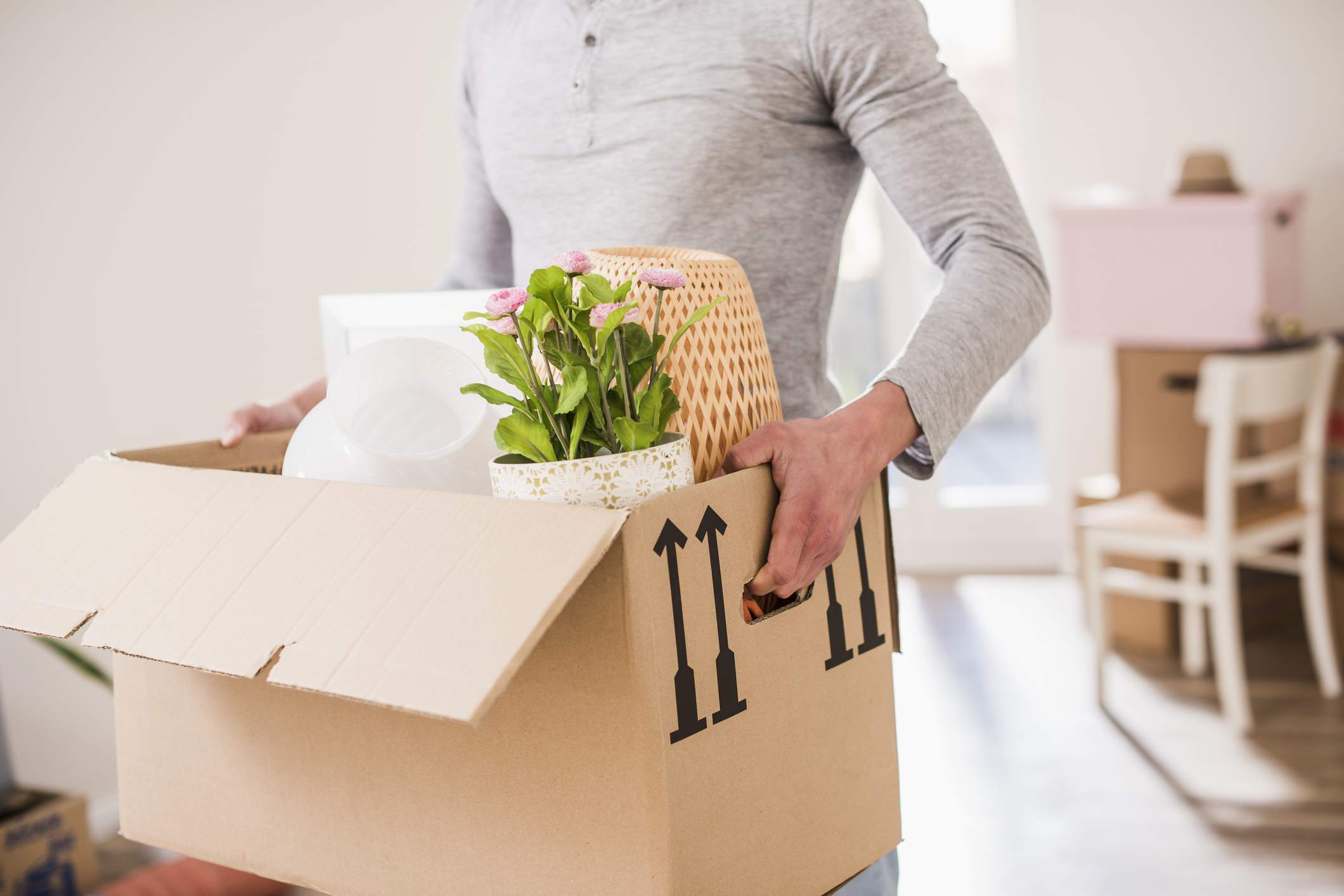 man moving a box