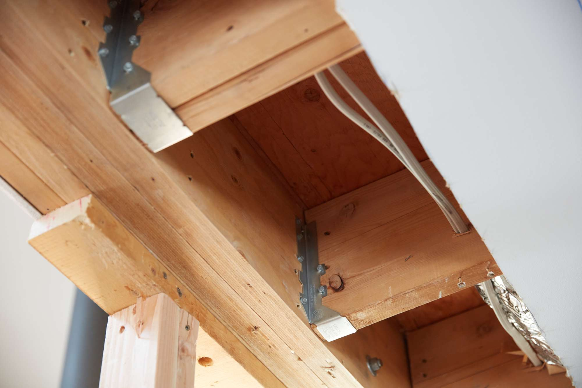 Wooden joists supporting ceiling