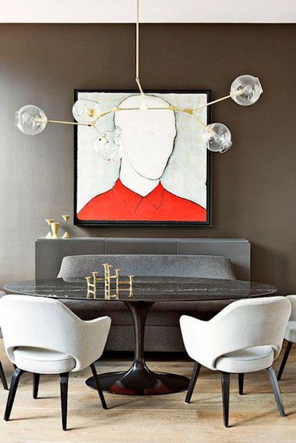 Gray Dining Room With Colorful Art And Modern Lighting