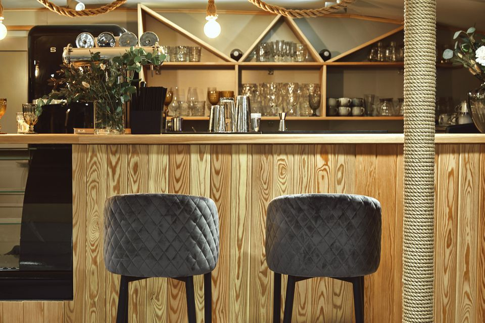 Simple home bar with wood bar surface