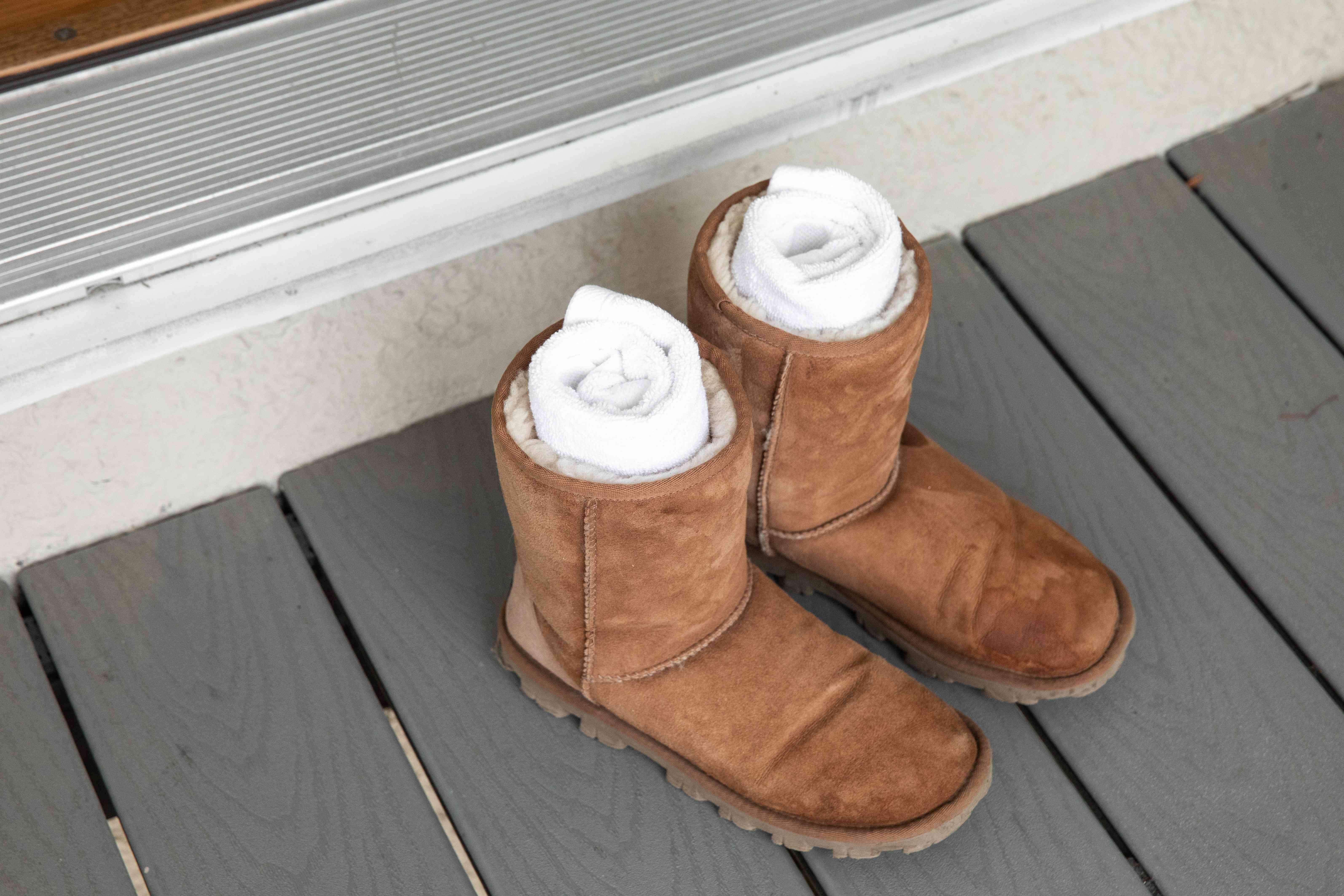 Rolled up towels in a pair of Ugg boots