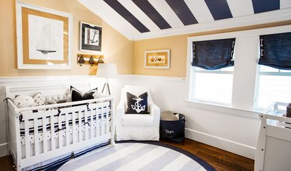 Nautical nursery with navy and white striped ceiling