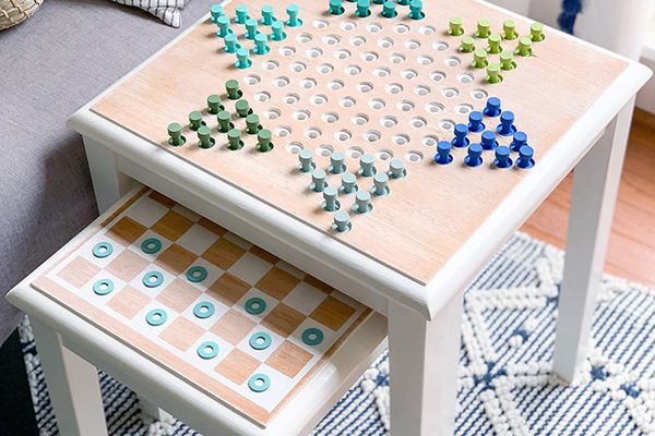 A Chinese checkers nesting table in a living room
