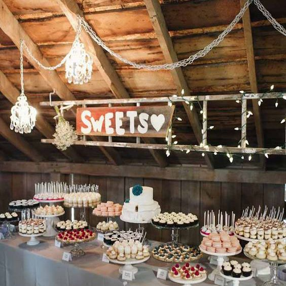 Dessert table at a barn wedding