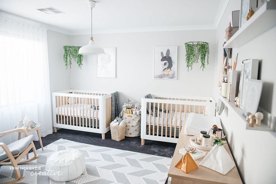 Boho chic twin nursery with nature theme