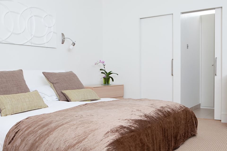 bed aligned with a door
