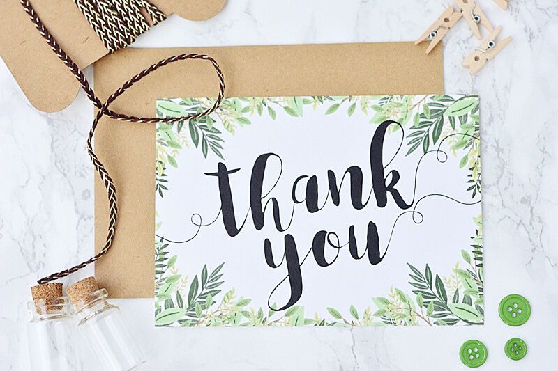 A green wedding thank you card with an envelope