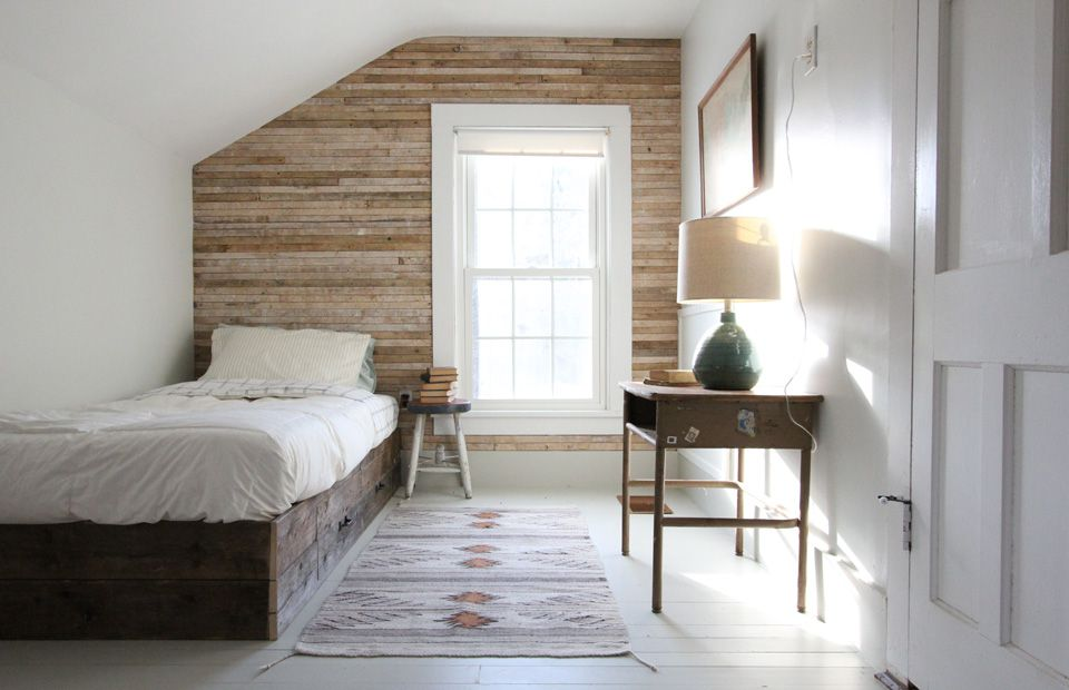 Bedroom with wooden wall