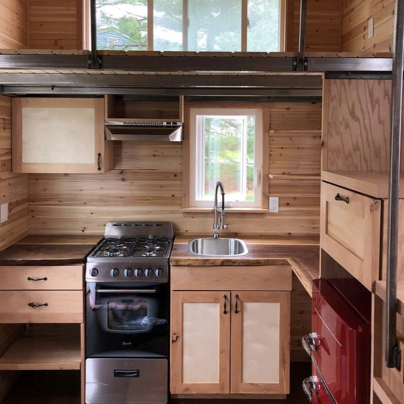 a tiny house kitchen constructed primarily of wood